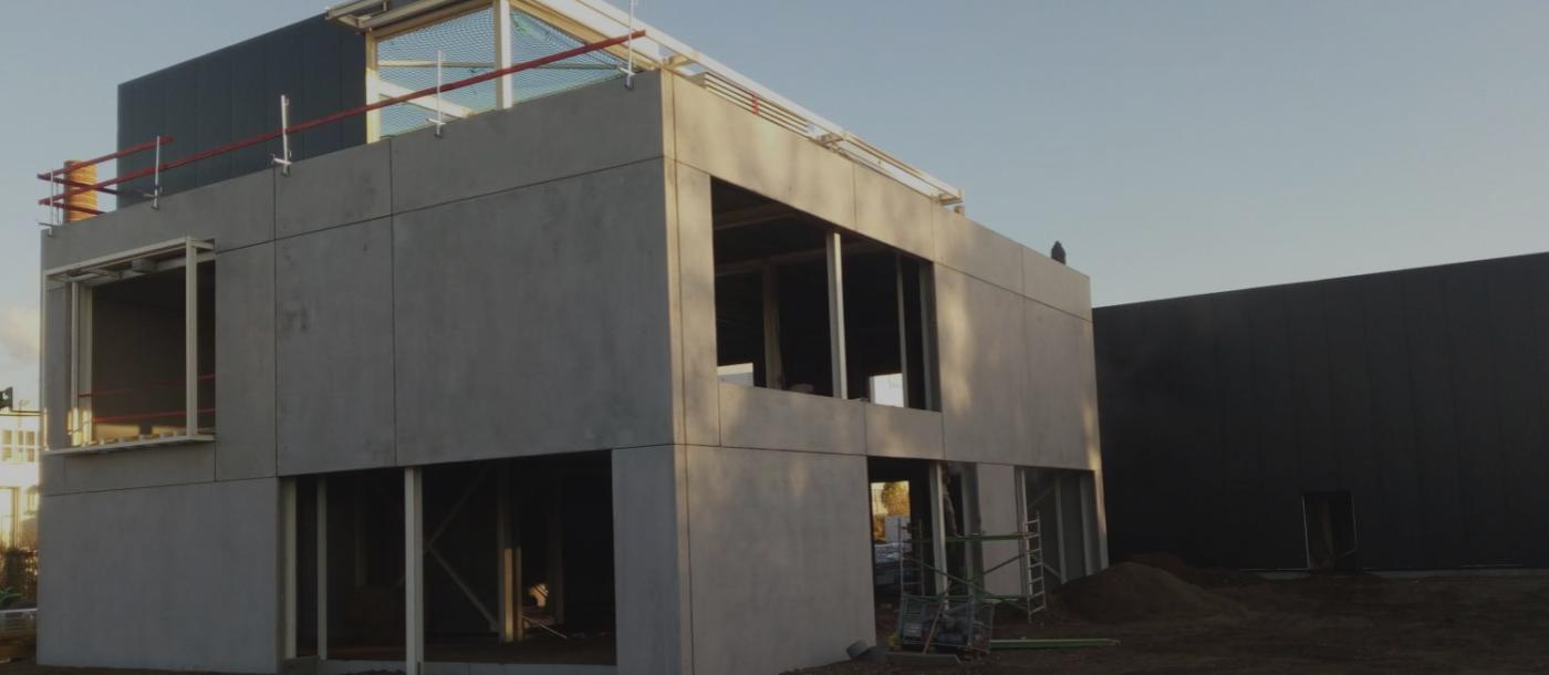 Voor Signina bouwen we een kantoorgebouw met loods